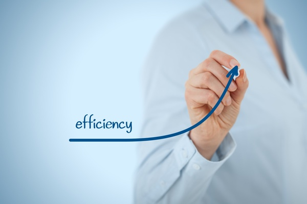 """person drawing an upward-sloping arrow with the word """"efficiency"""""""