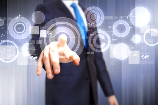 man in a suit points to a circle on a floating interface