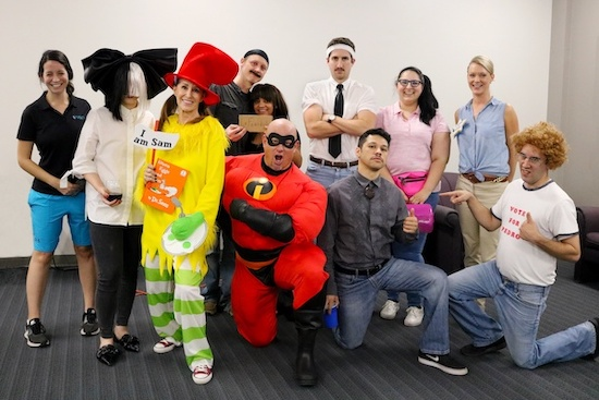 a group of people in various costumes