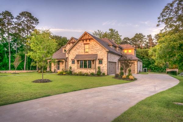 large brick house with big yard and long driveway