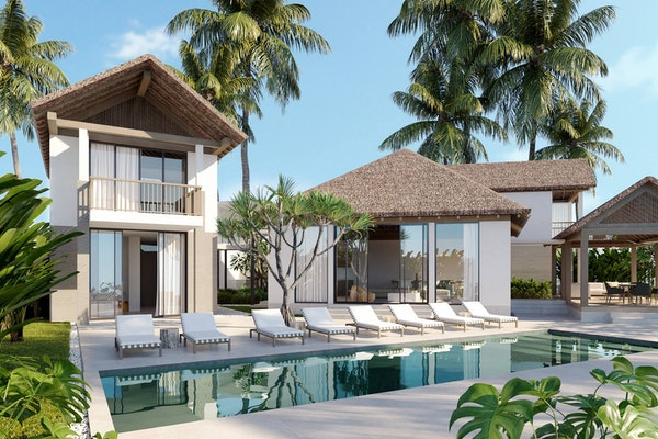 tropical vacation rental next to a pool, pool chairs, and palm trees
