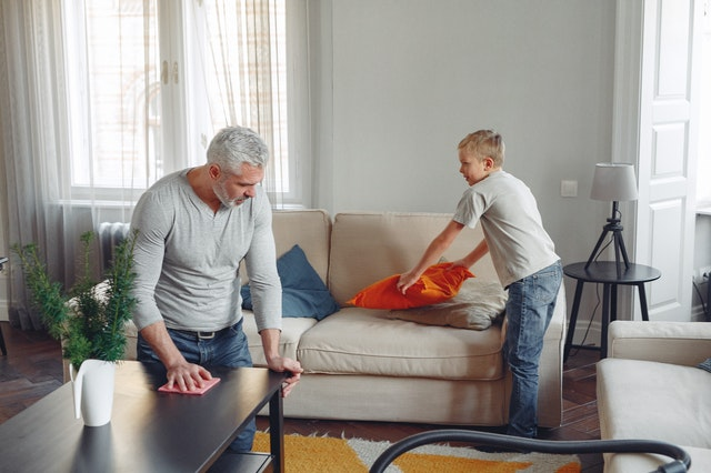 photo-of-man-cleaning-table-3890170