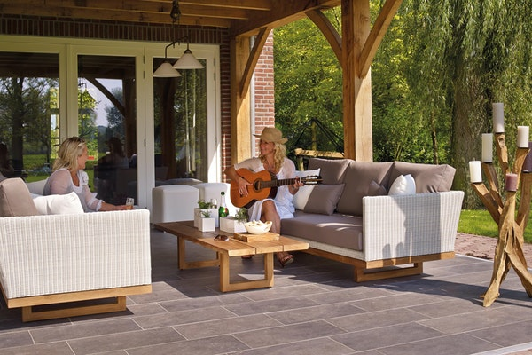 woman playing guitar on nice patio
